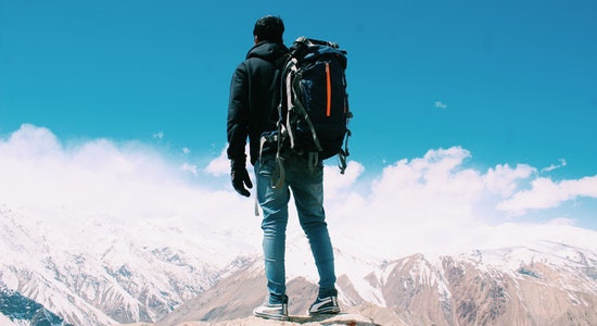 Traveller at the top of snow clad mountains