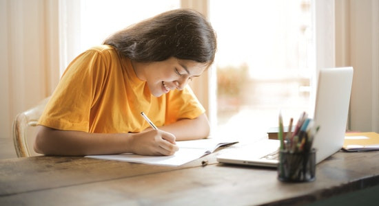 A girl completing her homework
