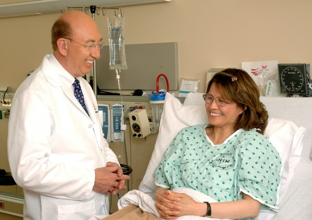 Anesthesiologist with patient after surgery